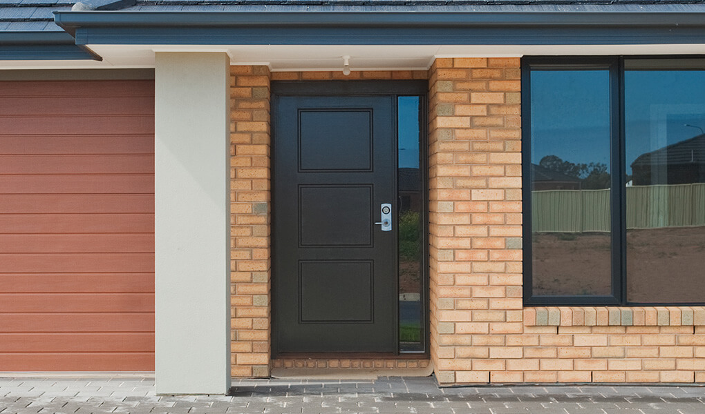 Black aluminium entrance door installation