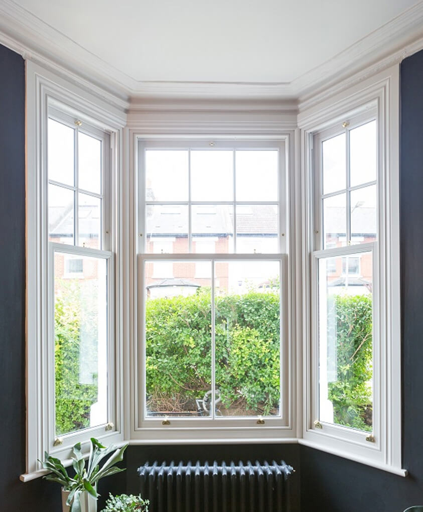 White timber vertical sliding windows interior view