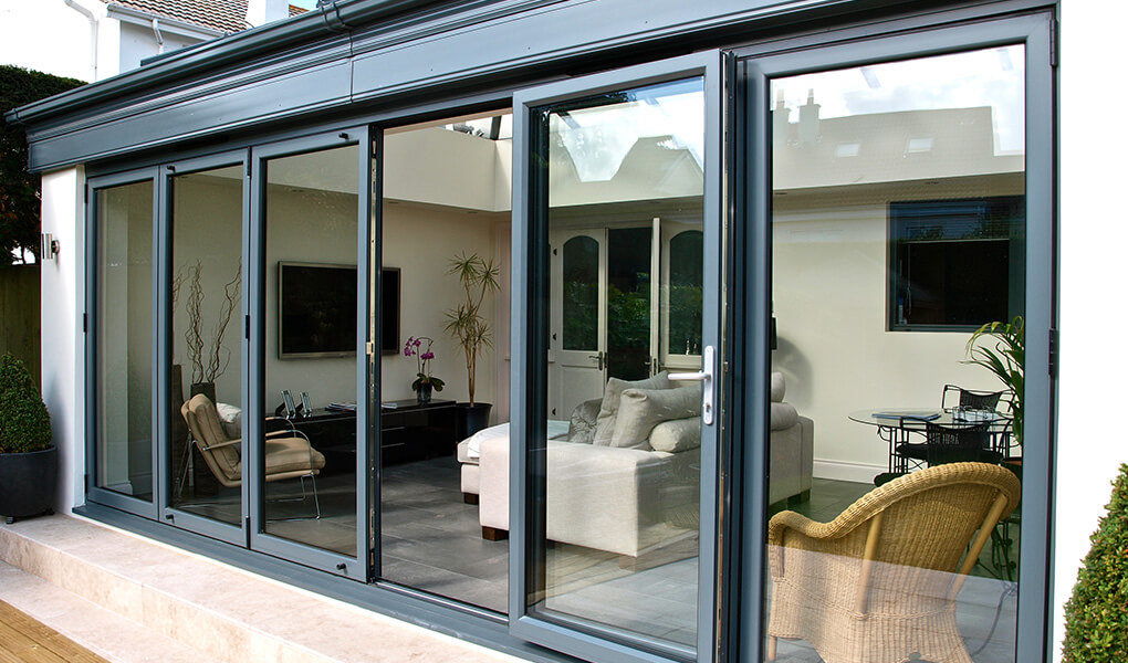 Open grey aluminium bifold door
