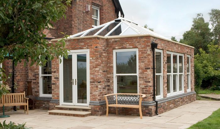 White uPVC and red brick Orangery