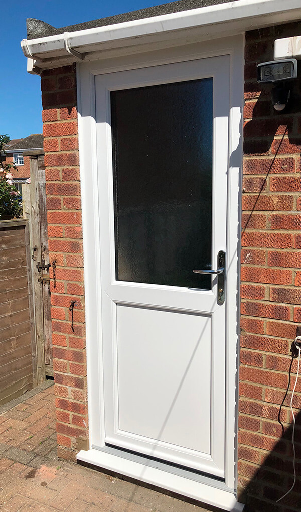 White uPVC entrance door installation