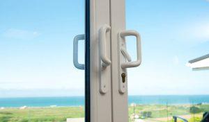 White uPVC patio door handles