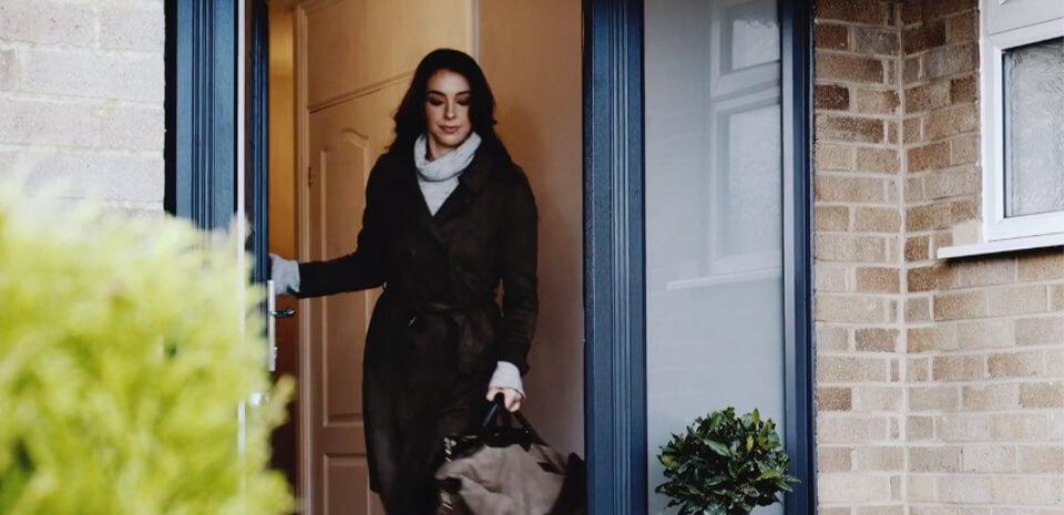woman leaving house