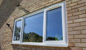 White uPVC casement window installation