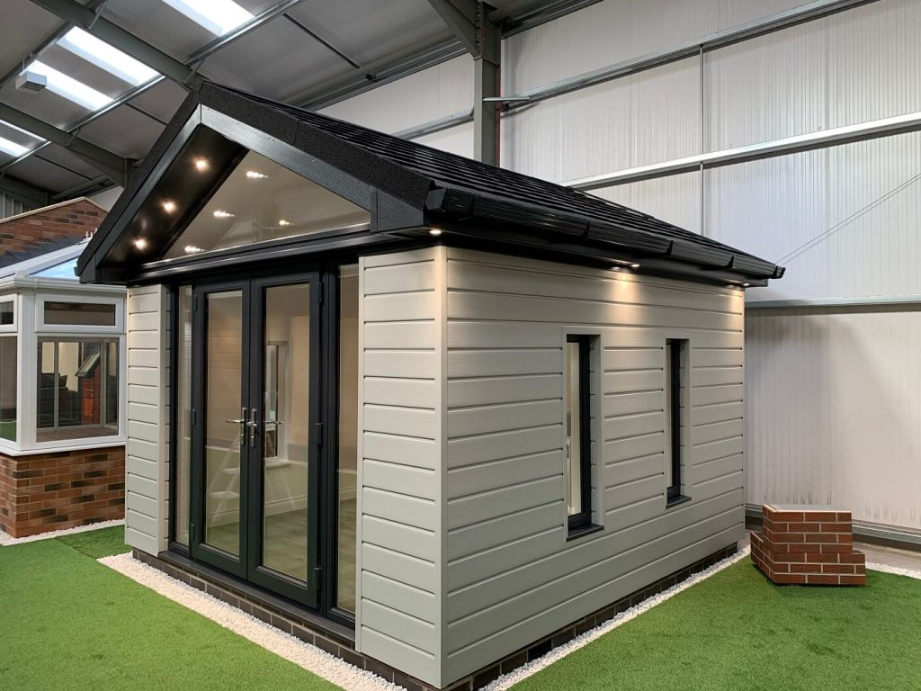 Pitched roof garden room with cream cladding